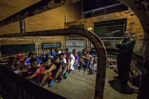 Police round up and detain young men early in the night in the hope that it will prevent more violence in Colombia's most dangerous city. (Photo: Alexander Villegas)